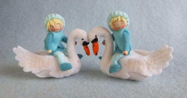 zwaan met twee kindjes
